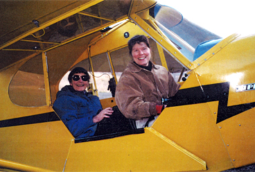 Lonni Sue and her mother in an airplane